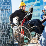 Teen with cerebral palsy rappels down Winnipeg skyscraper in her wheelchair