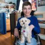 Student with cerebral palsy uses iPad to communicate