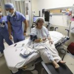 On bended knees: Rita DeMontis tackles surgery day